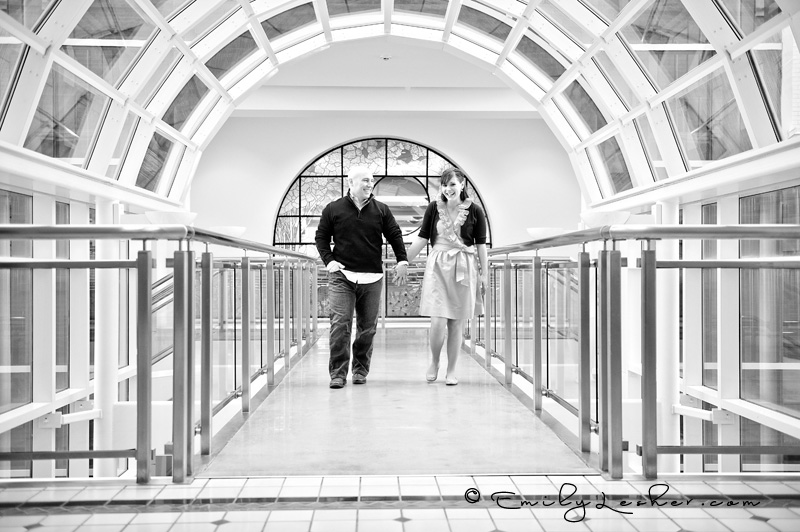 engagement picture in black and white, couple walking, arched windows
