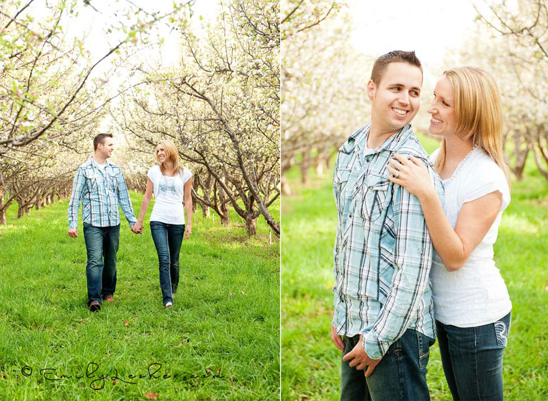 couple walking in orchard