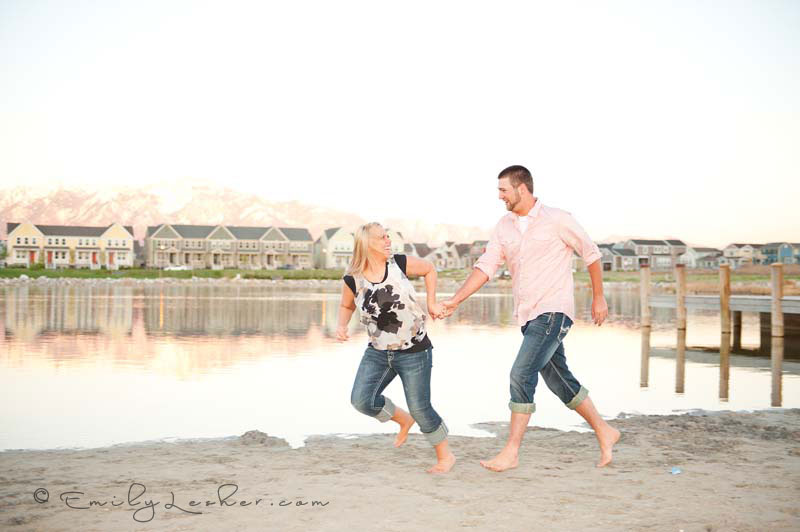 engaged couple running