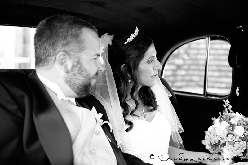 bride and groom in old car