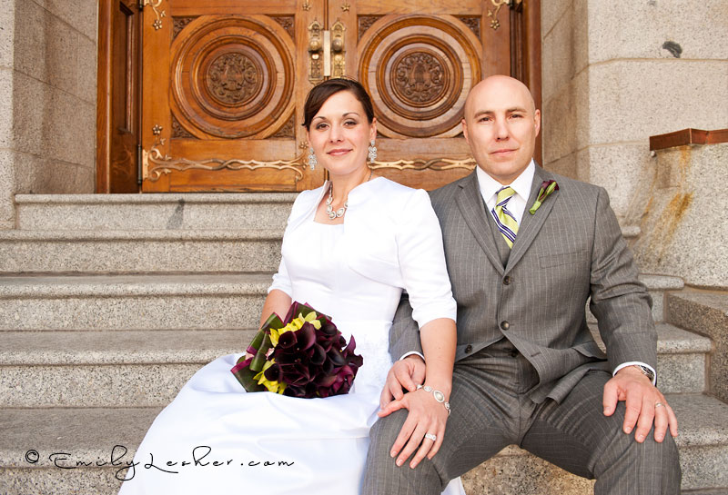 bride and groom on steps at the salt lake temple