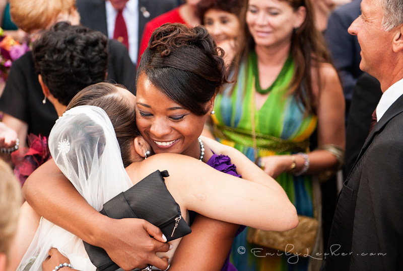 bride hugging guest, Saba wedding
