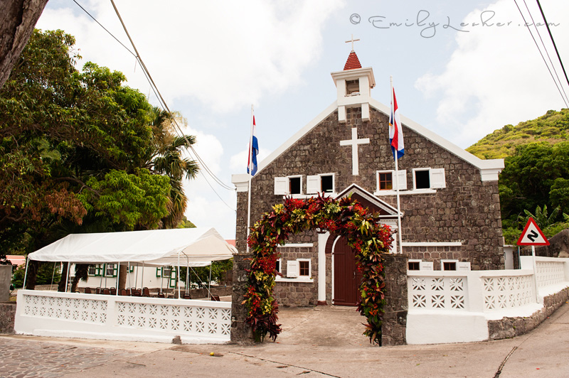 Catholic church, Saba, Flags, Mountains, trees, flower arch