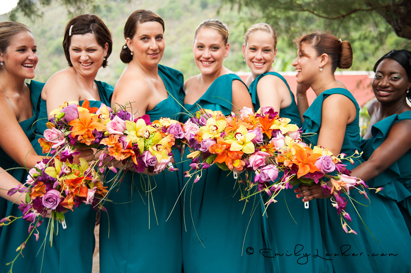 bridesmaids, and their bouquets, turquoise bridesmaid dresses, one shoulder dresses, bright colored flowers,
