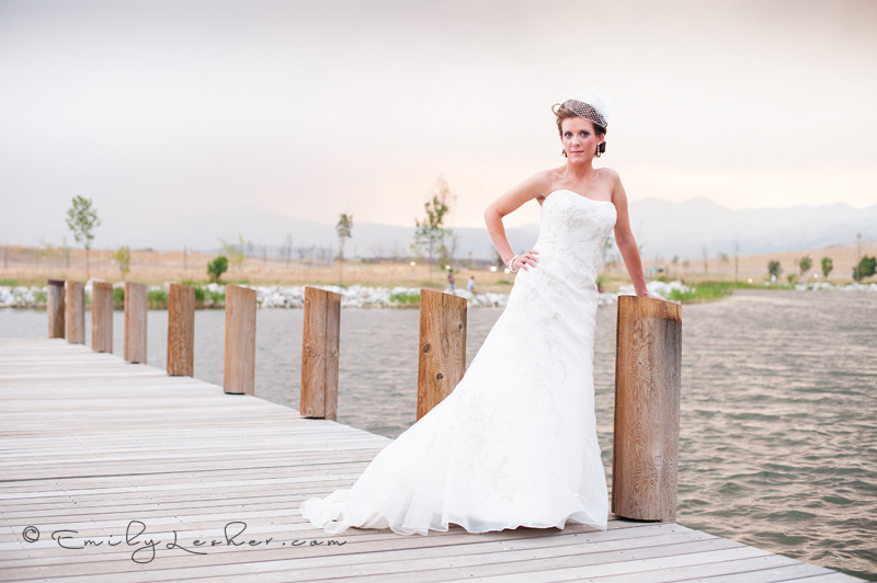 bride on dock, daybreak, pink sunset birdcage veil, strapless dress