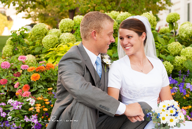 Wedding couple smiling in flower garden