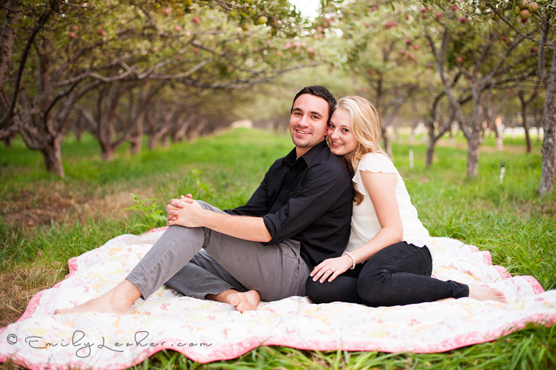 couple on a blanket, orchard,