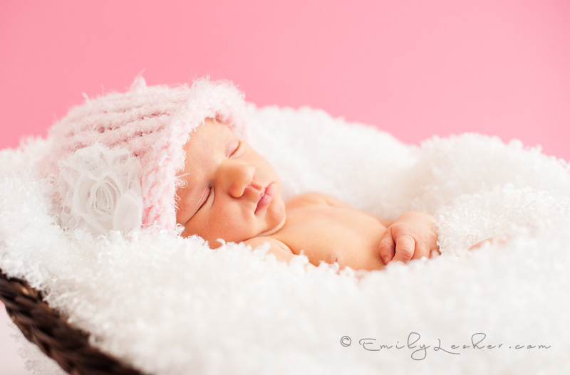 pink knitted baby hat, newborn sleeping, baby girl, pink backdrop
