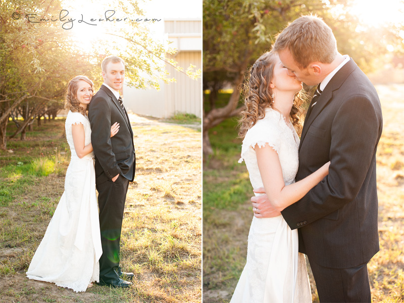 Ivory wedding gown, black suit, couple kissing, sunburst