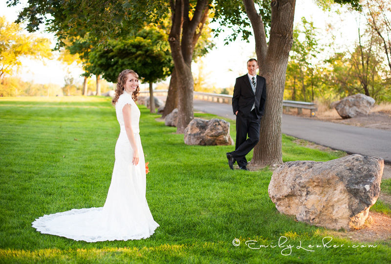bride and groom, green grass, row of trees, Provo