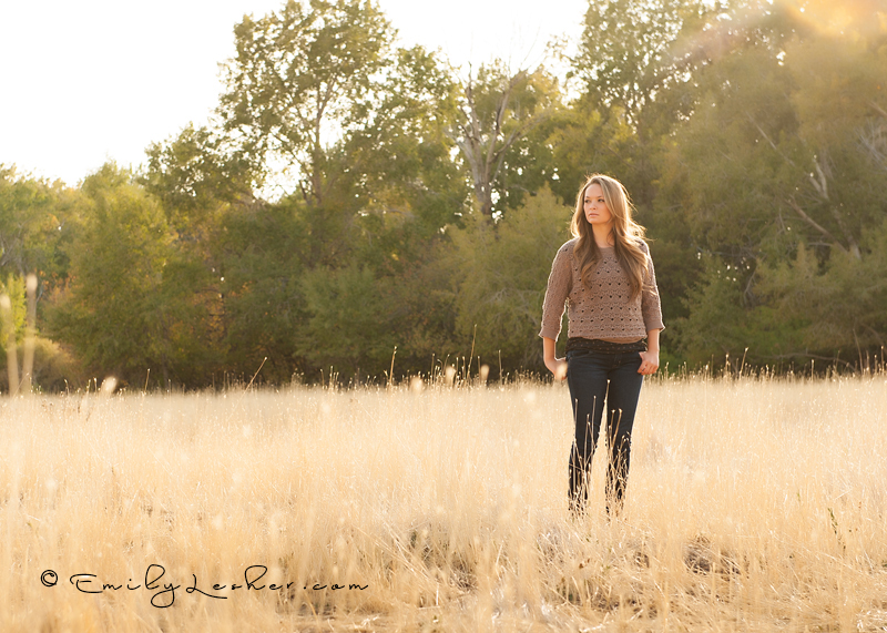model standing in field, fall, autumn, brown palette.