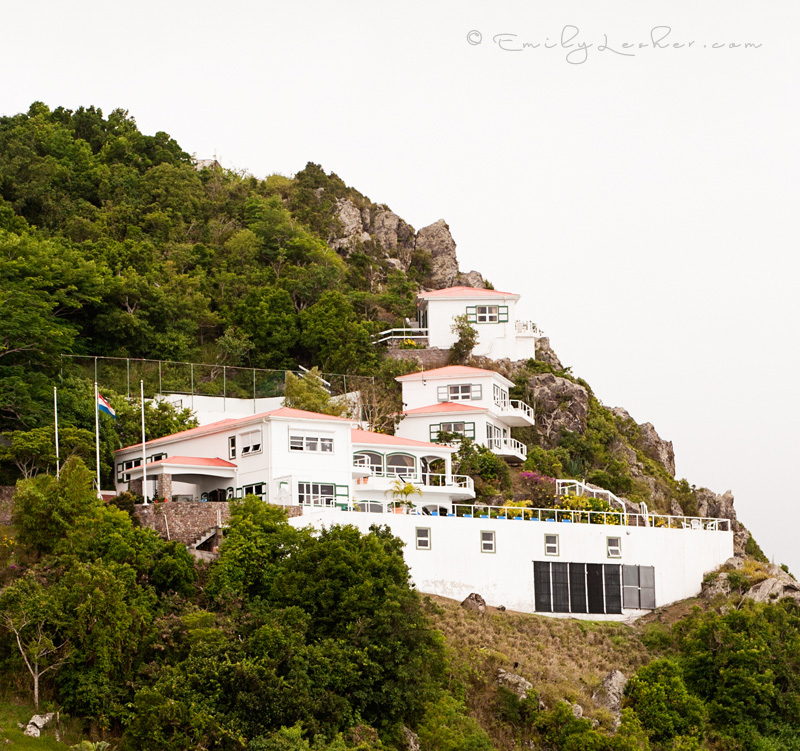 Shearwater Resort on Saba, view of the hotel Shearwater, mountains, greenery, cloudy skies