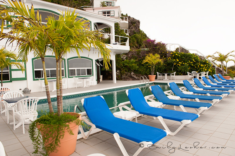 Shearwater Resort Pool, blue pool chairs, pool overlooking the ocean