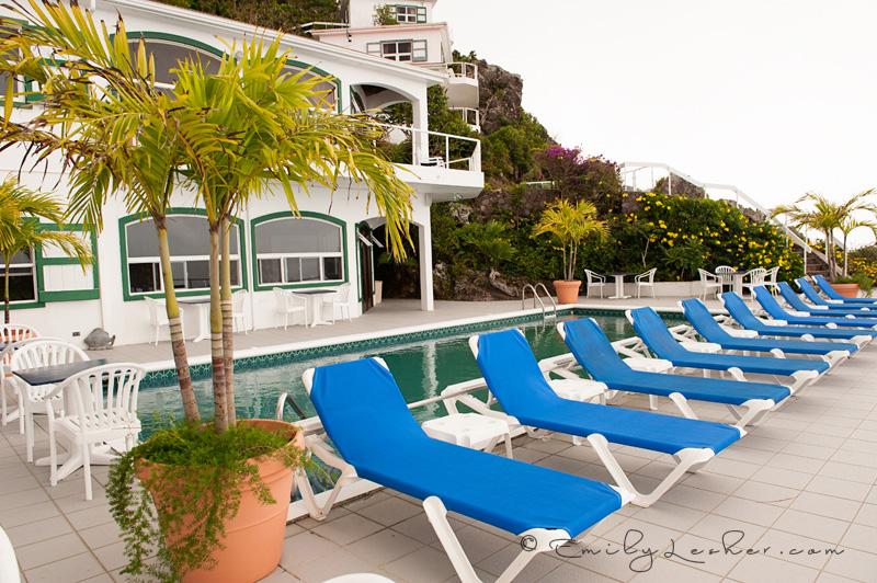 Shearwater Resort Pool, blue pool chairs, pool overlooking the ocean