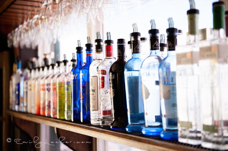 Alcohol bottles, bar, bar window, glasses, Caribbean