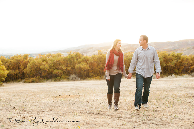 couple walking at sunset in the mountains, meadow, field, utah fall, fall leaves, fall colors,
