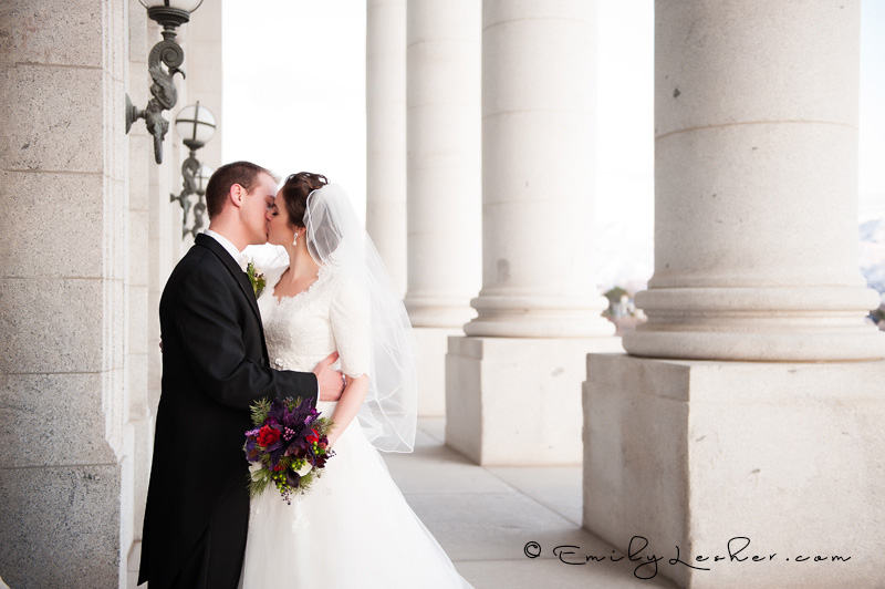 Pillars, bride and groom kissing, state capitol building