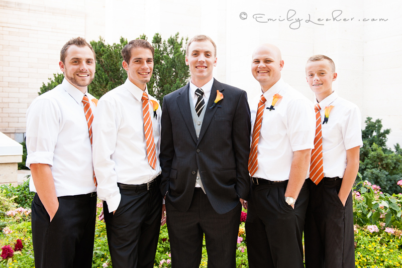 groomsmen, orange orchids, groomsmen lined up, orange and whit striped ties
