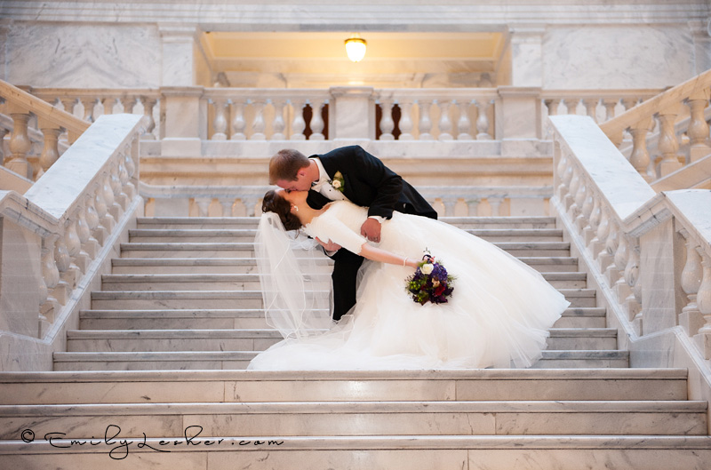 Groom dipping bride, steps at Utah State Capitol Building, 