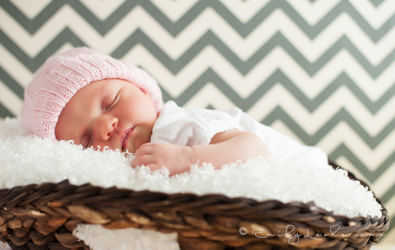 Newborn sleeping in hat, baby in basket, newborn girl, chevron striped wall, pink knit hat